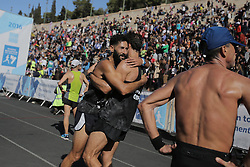 November 13, 2016 - Athens, Attica, Greece - Runners celebrate having just crossed the finish line of the 34th Athens Classic Marathon, at the Panathenaic stadium in Athens, Greece, on Sunday November 13, 2016. (Credit Image: © Panayiotis Tzamaros/NurPhoto via ZUMA Press)