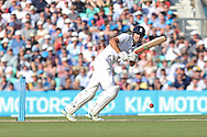 Wicketkeeper Jos Buttler of England scores runs during the 3rd day of the Investec Ashes Test match between England and Australia at the Oval, London, United Kingdom on 22 August 2015. Photo by Phil Duncan.