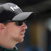 Sprint Cup Series driver Denny Hamlin (11) is seen in the garage area during the 57th Annual NASCAR Coke Zero 400 race first practice session at Daytona International Speedway on Friday, July 3, 2015 in Daytona Beach, Florida.  (AP Photo/Alex Menendez)