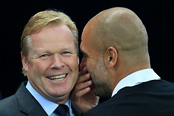 21st August 2017 - Premier League - Manchester City v Everton - Man City manager Pep Guardiola (R) whispers to Everton manager Ronald Koeman - Photo: Simon Stacpoole / Offside.