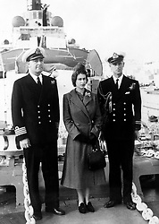 File photo dated 26/12/49 of The Duke of Edinburgh and Captain John Edwin Home McBeath DSO, DSC, RN (left), pose with Queen Elizabeth II for a photograph on HMS Chequers, during the Boxing Day visit to the destroyer that the Duke is currently serving on. Philip joined the Navy after leaving school and in May 1939 enrolled at the Royal Naval College in Dartmouth, where he was singled out as best cadet. He rose rapidly through the ranks, earning promotion after promotion, but his life was to take a very different course. The dukeÕs flourishing naval career came to a premature end in 1951. Philip stepped down from his active role in the forces to fulfil his duty as consort. Issue date: Friday April 4, 2021.