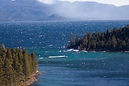 A frigid east wind creates swell at the rocky mouth of Emerald Bay.