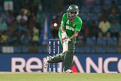 © Licensed to London News Pictures. 25/09/2012. Bangladesh batsmen Shakib Al Hasan plays an unorthodox shot while batting during the T20 Cricket World T20 match between Pakistan Vs Bangladesh at the Pallekele International Stadium Cricket Stadium, Pallekele. Photo credit : Asanka Brendon Ratnayake/LNP