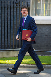 Business Secretary Greg Clark arrives at 10 Downing Street in London for a Cabinet meeting.