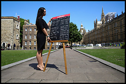 June 7, 2017 - London, London, United Kingdom - Image ©Licensed to i-Images Picture Agency. 07/06/2017. London, United Kingdom. Ladbrokes General Election Odds. .A member of staff from Ladbrokes places their General Election odds on a chalkboard on College Green opposite the Houses of Parliament...Picture by Dinendra Haria / i-Images (Credit Image: © Dinendra Haria/i-Images via ZUMA Press)