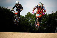#53 (PRIES Nadja) GER and #75 (VAN BENTHEM Merle) NED on the first straight at the UCI BMX Supercross World Cup in Papendal, Netherlands.