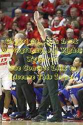 12 January 2013:  Referee Bob Staffen signals a completed 3 point shot during an NCAA Missouri Valley Conference mens basketball game Where the Bulldogs of Drake University beat the Illinois State Redbirds 82-77 in Redbird Arena, Normal IL
