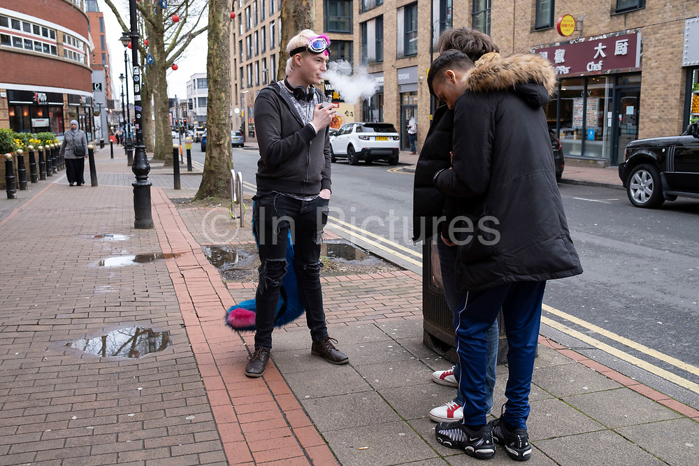 Furry without his head on vaping outside a bar on 14th March 2020 in Birmingham, United Kingdom. The furries fandom is a subculture interested in fictional anthropomorphic animal characters with human personalities and characteristics. Examples of anthropomorphic attributes include exhibiting human intelligence and facial expressions, the ability to speak, walk on two legs, and wear clothes. Furry fandom is also used to refer to the community of people who gather on the Internet and at furry conventions.