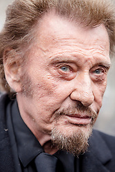File photo : French singer Johnny Hallyday during a national tribute to the victims of the January and November 2015 terror attacks, at Place de la Republique square in Paris, France on January 9, 2016. France's biggest rock star Johnny Hallyday has died from lung cancer, his wife says. He was 74. The singer - real name Jean-Philippe Smet - sold about 100 million records and starred in a number of films. Photo by Denis Allard/Pool/ABACAPRESS.COM