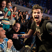 WASHINGTON, D.C. - November 7th, 2012 - Danny O'Donoghue of The Script enlists a seated concert goer to help sing during the band's performance at DAR Constitution Hall in Washington, D.C.  (Photo by Kyle Gustafson/ For The Washington Post)