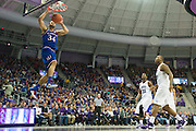 FORT WORTH, TX - FEBRUARY 6: Perry Ellis #34 of the Kansas Jayhawks catches an alley-oop against the TCU Horned Frogs on February 6, 2016 at the Ed and Rae Schollmaier Arena in Fort Worth, Texas.  (Photo by Cooper Neill/Getty Images) *** Local Caption *** Perry Ellis