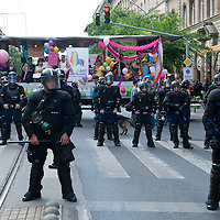Police officers in riot gear line up to protect participants of the Gay Pride March from planned attacks of far-right anti-protesters in Budapest, Hungary on June 18, 2011. ATTILA VOLGYI