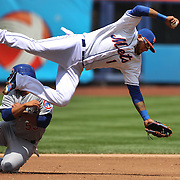 New York Mets short stop Jordany Valdespin is sent head over heals by Welington Castillo, Chicago Cubs, as he breaks up a double play attempt during the New York Mets V Chicago Cubs Baseball game at Citi Field, Queens, New York. USA. 15th June 2013. Photo Tim Clayton