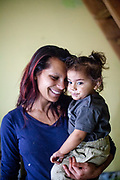 Maria (22) mother of four children with one of her daughters in their new house at the village of Rankovce, close to Kosice in eastern Slovakia. The foundation ETP Slovakia has a project in Rankovce setting up micro-loan funds for the local Roma community. Loans from this fund will enable families to build their own low-cost brick homes, on land they own.