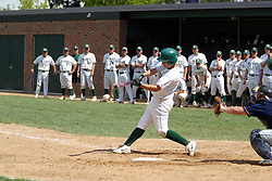 22 April 2006:  ....Titan Pat Cinquegrani makes contact driving the ball up the middle.  The whole Titan dugout stands in anticpation of the hit.  Pats' single drove in the winning run in the bottom of the 9th inning.....In CCIW, Division 3 action, the Titans of Illinois Wesleyan capped the Auggies of Augustana College by a scor of 3-2 in game one of a double card afternoon.  Games were held at Jack Horenberger field on the campus of Illinois Wesleyan University in Bloomington, Illinois