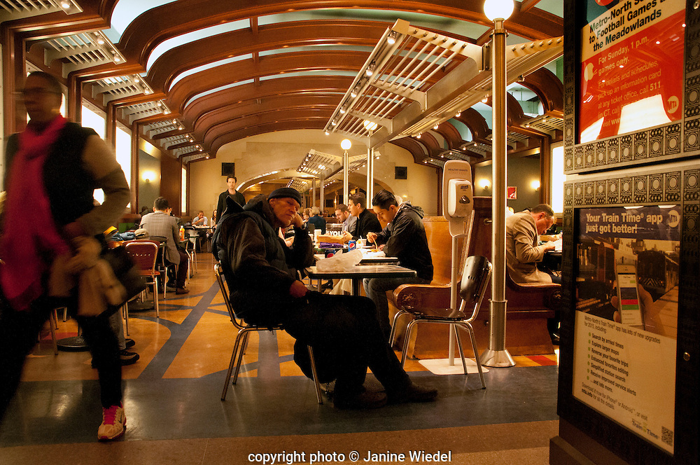 People eating in restaurant in basement of Grand Central Station New York City