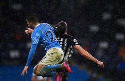 Joao Cancelo of Manchester City (L) and Andy Carroll of Newcastle United in action - Mandatory by-line: Jack Phillips/JMP - 26/12/2020 - FOOTBALL - Etihad Stadium - Manchester, England - Manchester City v Newcastle United - English Premier League