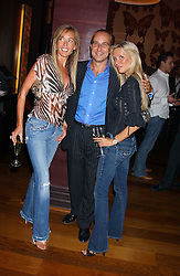 Left to right, GRACE RICCI, PAUL McKENNA and CHARMIAN TAYLOR at a party to celebrate the publication of 'Everything I Know About Men I Learnt From My Dog' by Clare Staples held at Fifty, St.James's, London on 7th September 2005.<br /><br />NON EXCLUSIVE - WORLD RIGHTS