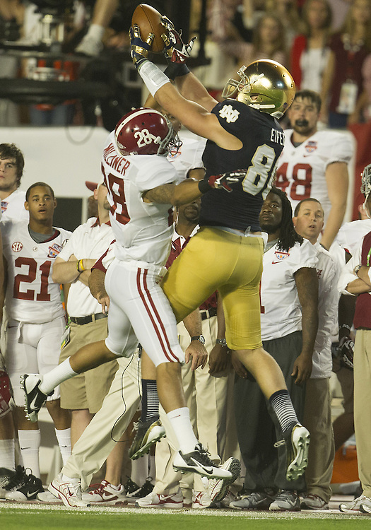 January 7, 2013:  Notre Dame tight end Tyler Eifert (80) goes up for the ball as Alabama defensive back Dee Milliner (28) defends during the Discover BCS National Championship between the Alabama Crimson Tide and the Notre Dame Fighting Irish at Sun Life Stadium in Miami Gardens, Florida.  Alabama defeated Notre Dame 42-14.