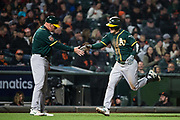 Oakland Athletics right fielder Mark Canha (20) circles the bases after hitting a solo home run against the San Francisco Giants at AT&T Park in San Francisco, California, on March 26, 2018. (Stan Olszewski/Special to S.F. Examiner)