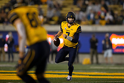 California quarterback Chase Garbers (7) rolls out to pass against Nevada during the first quarter of an NCAA college football game, Saturday, Sept. 4, 2021, in Berkeley, Calif. (AP Photo/D. Ross Cameron)
