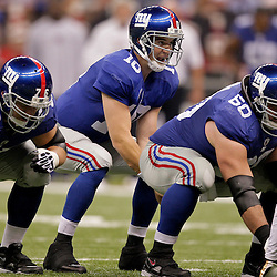 2009 October 18: New York Giants quarterback Eli Manning (10) under center during a regular season game between the New Orleans Saints and the New York Giants at the Louisiana Superdome in New Orleans, Louisiana.