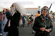Two masqueraders having fun in Mindelos Carnival.
