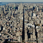 An aerial shot looking right into the canyon of 5th Avenue as it winds up the Manhattan cityscape.