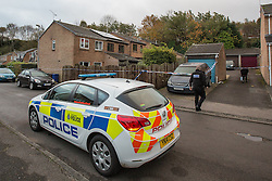 © Licensed to London News Pictures . 23/10/2014 . Penistone , UK . A fire in a house on Tennyson Close in Penistone near Barnsley has killed a nine year old boy and a 44 year old man and a boy aged 11 is critically ill in hospital . The house ( pictured with solar panels on the roof and smashed windows ) is cordoned off by police . Photo credit : Joel Goodman/LNP