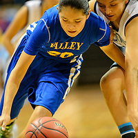 011915  Adron Gardner/Independent<br /> <br /> Valley Sanders Pirate Chenelle Speen (20) holds off Window Rock Scout Alicia Hale (25) after stealing the ball at the Stronghold Event Center in Fort Defiance Monday.
