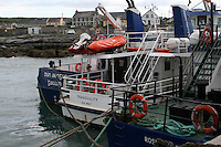 passenger ferry boats at Inis Oirr the Aran Islands in Galway Ireland