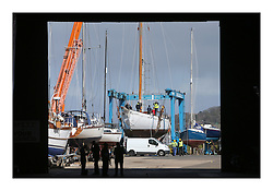Kentra - A Wm. Fife Designed Classic Yacht which has been in storage for the past 7 years at Fairlie Quay is moved outside and has it's main mast put in place.