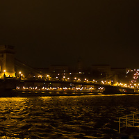 Cityscape showing the Castle of Buda (back) and the Chain Bridge (front) during (bottom) the Earth Hour blackout in Budapest, Hungary on March 31, 2012. ATTILA VOLGYI