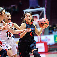 Portales Rams Lindsay Blakey (23), left, and Alexis Garcia follow (12) Shiprock Chieftain Laila Charley (4) to the basket in a District 4A semifinal at The Pit in Albuquerque Thursday.