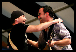 April 29th, 2006. New Orleans, Louisiana. Jazzfest . The New Orleans Jazz and Heritage festival. Dave Matthews of The Dave Matthews Band performs on the Acura Stage with special surprise guest 'The Edge,' from the supergroup U2.