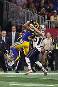 Los Angeles Rams cornerback Marcus Peters (22) leaps in the air and breaks up a deep pass intended for New England Patriots wide receiver Chris Hogan (15) on a third down play and forcing a punt during the NFL Super Bowl 53 football game on Sunday, Feb. 3, 2019, in Atlanta. The Patriots defeated the Rams 13-3. (©Paul Anthony Spinelli)