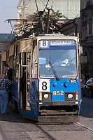 locals disembark tram in krakow poland