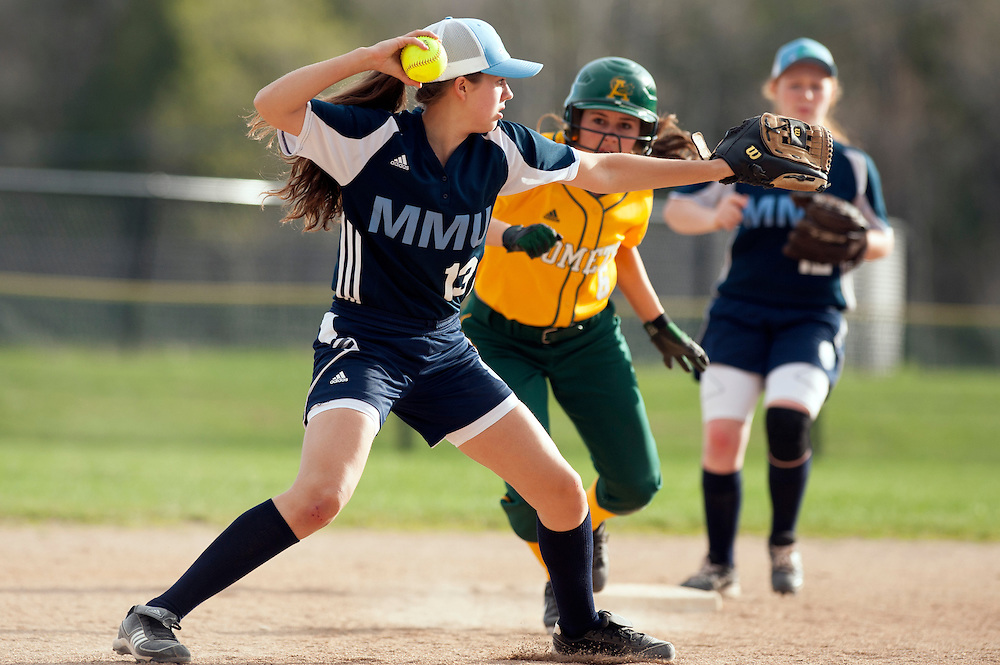 MMU's Felicia Forsyth throws the ball to first base for an out during the girls softball game between BFA-St. Albans and Mount Mansfield at MMU High School on Thursday afternoon May 8, 2014 in Jericho, Vermont. (BRIAN JENKINS, for the Free Press)