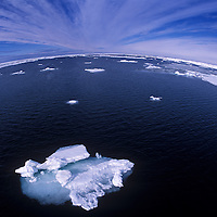 Photograph of the Arctic Ocean and Iceberg and pack ice from the bow of a boat using a fisheye lens 500 mlles from the North Pole.