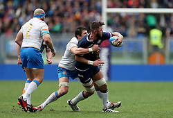 Scotland's Ryan Wilson is tackled during the NatWest 6 Nations match at the Stadio Olimpico, Rome.