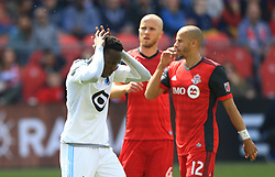 TORONTO, May 14, 2017  Abu Danladi (L) of Minnesota United FC reacts after missing a goal during the 2017 Major League Soccer (MLS) match between Toronto FC and Minnesota United FC at BMO Field in Toronto, Canada, May 13, 2017. Toronto FC won 3-2. (Credit Image: © Zou Zheng/Xinhua via ZUMA Wire)