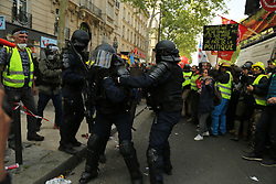 May 1, 2019 - Thousands gathered for May Day protests in the French capital with clashes breaking out between some of the protesters and the police.  Many demonstrators worn the yellow vest and some Black Bloc anti-capitalist groups also joined the marches. Several hundreds of police officers had been deployed in Paris, and they fired tear gas, but also rubber bullets and baton charges to push back demonstrators. Thousands of people joined this year May Day rally in France to fight for workers' rights and to protest against President Emmanuel Macron's economic policies. According to the French labour union CGT, all marches in France were peaceful, with the exception of Paris (Credit Image: © Louai Barakat/IMAGESLIVE via ZUMA Wire)