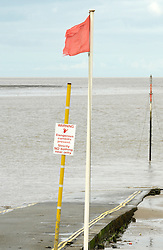 © Licensed to London News Pictures. 20/08/2012. Burnham-on-Sea, Somerset, UK.  A red flag flies on the jetty at the sea front where a 4 year old boy fell off the beach jetty on Sunday night.  Emergency services are now working on the basis of recovering a body. The area has one of the highest tidal ranges in the world with strong currents especially around the jetty.  20 August 2012..Photo credit: Simon Chapman/LNP