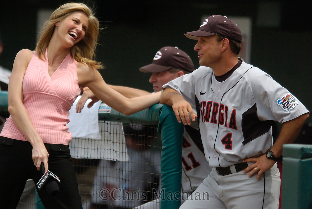06/17/2006  Georgia head coach  David Perno gets interviewed by ESPN's Erin Andrews in the fifth inning during, game 3 of the College World Series in Omaha Nebraska Saturday afternoon.Photo by Chris Machian