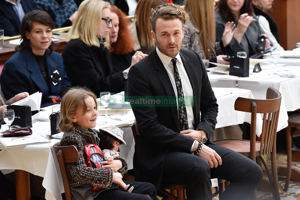 File photo - Brad Kroenig and his son Hudson during the Chanel show as part of the Paris Fashion Week Womenswear Fall/Winter 2015/2016 on March 10, 2015 in Paris, France. Karl Lagerfeld died on Monday at age 85. One who may inherit is his godson Hudson. Hudson's dad, model Brad Kroenig, is like 'family' to Lagerfeld. Hudson began modeling for Chanel at age two and had continued to pop up on the runway ever since. Photo by Nicolas Gouhier/ABACAPRESS.COM
