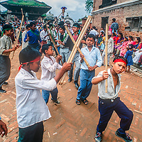 Newari Hindus in Bhaktapur, Nepal, gather to celebrate Gai Jatra (the cow festival) where families honor their dead and march or dance through the city, performing  to encourage their passing to heaven.