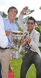 Left to right, JACK RICHARDSON and DOMINIC COOPER at the Audi International Polo at Guards Polo Club, Windsor Great Park, Egham, Surrey on 26th July 2014.