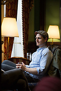 A young man sitting in The Library Bar on 04th April 2017 in Dublin, Republic of Ireland. Dublin is the largest city and capital of the Republic of Ireland.