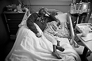 Debra Simpson gets in bed with her daughter, Kya Simpson Freeman, at the end of the day at Rush University Medical Center on Monday March 7, 2011. Whenever Kya comes in for extended stay at the Hospital Debra lives out of the hospital with her sharing the same hospital bed.