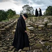 A monk crosses a dam on the Sarthe during their traditional weekly walk outside the abbey. Solesmes on 17-10-2019<br /> Un moine traverse un barrage sur la Sarthe au cours de leur traditionnelle promenade hebdomadaire à l'extérieure de l'abbaye. Solesmes le 17-10-2019